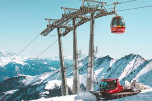 Ski gondola and piste basher