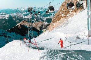 Skiers Under Ski Lift