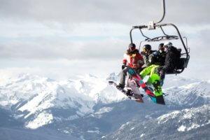 Snowboarders On Ski Lift