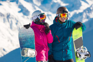 Happy couple snowboarding
