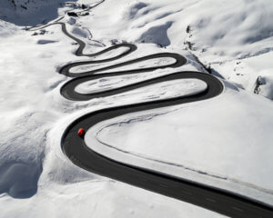 Snowy road in Swiss Alps